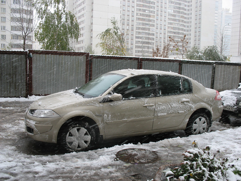 Our car in front of our apartment building. Those metal boxes are garages, which, fortunately, were removed by the city. (10.2007)