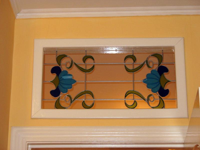 Glass panel above kitchen door.