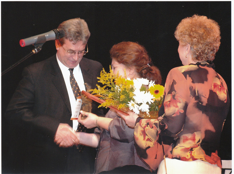 Receiving award sculpture, salutation (диплом), and flowers.