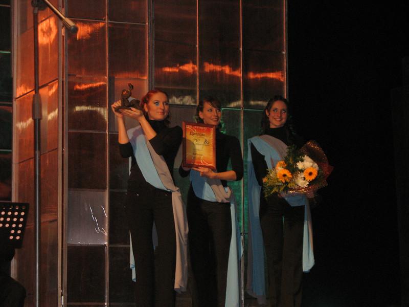 "The awards - sculpture, ""diploma"", flowers."
