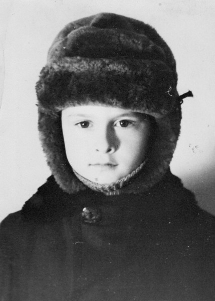 Serious boy in his winter hat.