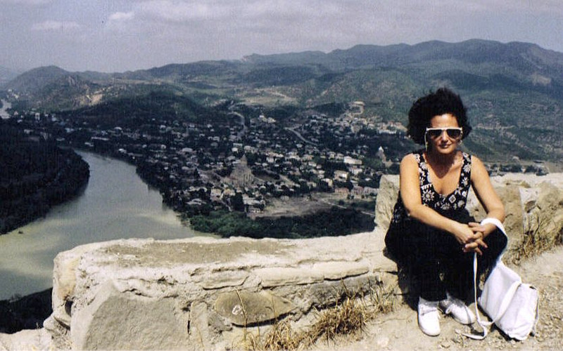 Susan on the Georgian Military Highway overlooking Tblisi. USSR (1990)
