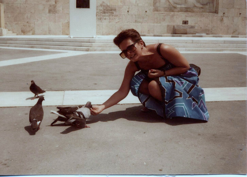 Feeding the pigeons in Athens.