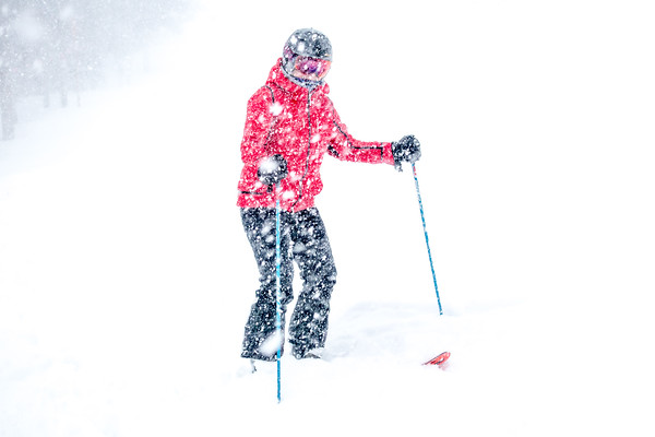 Snowstorm cold skier