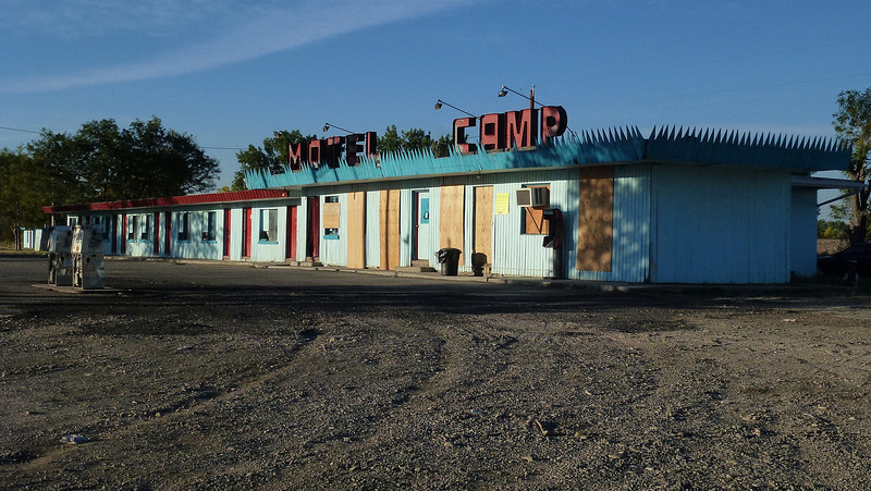 a closed and boarded up motel  on the highway just over from Little Big Horn