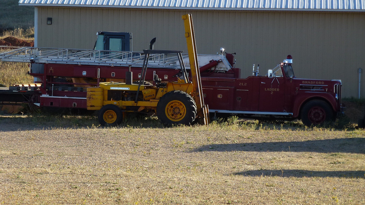 These old fire engines were in same yard as the old trucks. We have come to the conclusion that no one throws any type of vehicle away.It is left in the yard or paddock forever.and!!!!!! right beside the house.
