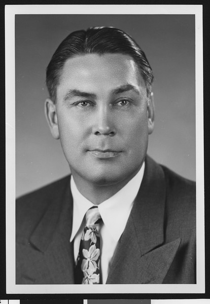University of Southern California assistant football coach Mel Hein, studio shot in flowered tie and dark jacket, 1951.