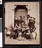 Kappa Alpha Theta sorority women in front of an entrance to a building, ca. 1880-1919