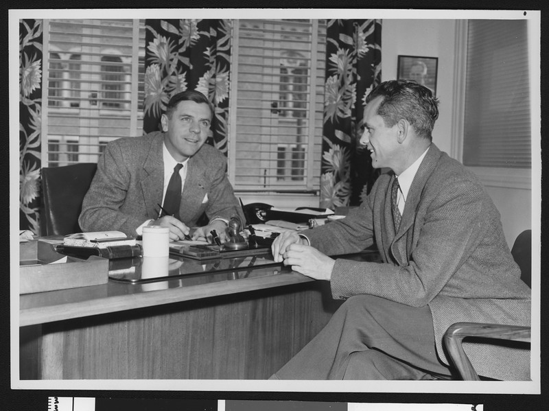 Alumni Review editor Arnold Eddy (left) and University of Southern California coach Jess Hill, USC campus, 1947.