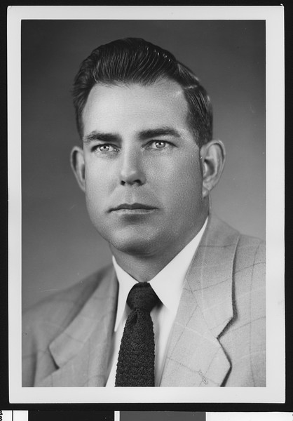 University of Southern California assistant football coach Bill Fisk, studio shot in dark tie and light jacket, 1951.