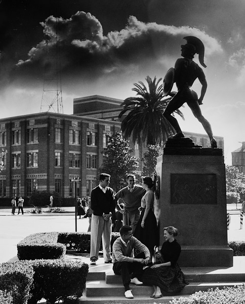 Three men and two women at the base of Tommy Trojan or Trojan Shrine, USC, ca. 1945-1955