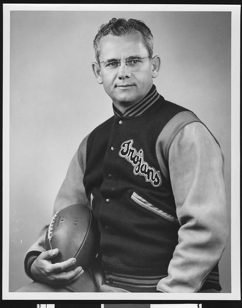University of Southern California head football coach Jess Hill, studio shot in letter jacket, 1951.