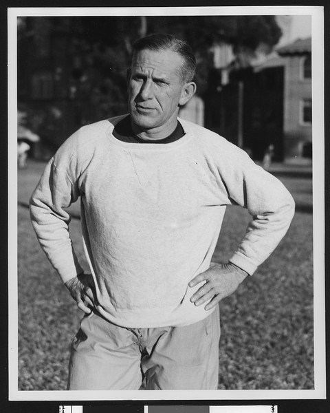 University of Southern California football coach Howard Jones, hands on hips, USC campus, 1933.