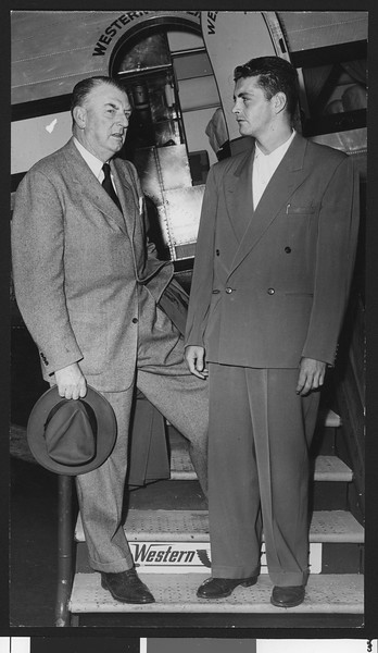 University of Southern California baseball coach Sam Barry with Wally Hood in front of a Western Airline plane at Los Angeles Airport, 1948.