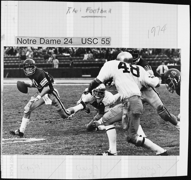 USC player holding the football  in the comeback game against University of  Notre Dame, 1974