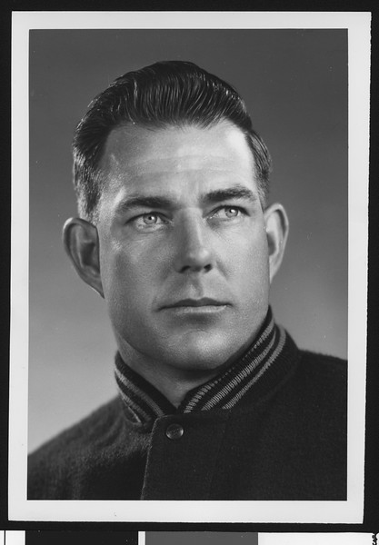 University of Southern California assistant football coach Bill Fisk, studio shot in letter jacket, 1951.