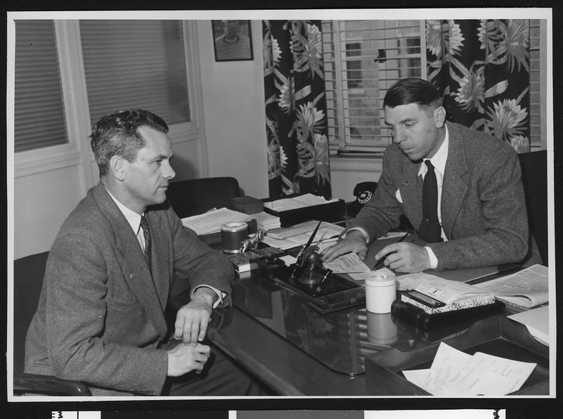 University of Southern California coach Jess Hill (left) and Alumni Review editor Arnold Eddy, USC campus, 1947.