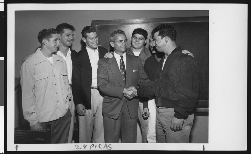 University of Southern California head football coach Jess Hill being congratulated by the football team on his appointment as head coach, USC campus, January 1951.