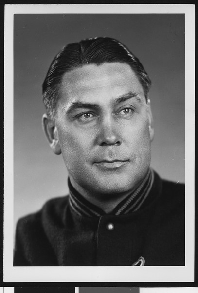 University of Southern California assistant football coach Mel Hein, studio shot in letter jacket, 1951.