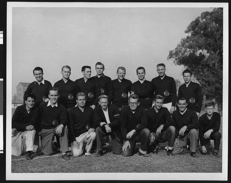University of Southern California football management staff (not coaches) formal picture #1, half the managers kneeling and half standing, 1949 season, on Bovard Field, USC campus.