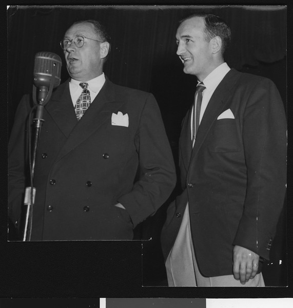 University of Southern California head football coach Jeff Cravath with telecaster Tom Harmor, student homecoming rally, 1949.