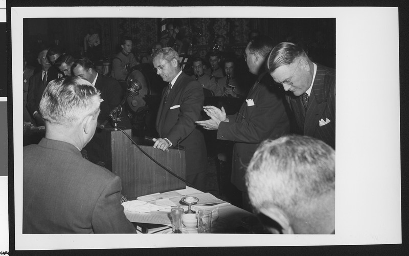 University of Southern California head football coach Jess Hill has just finished speaking to a large crowd at a lunch celebrating his appointment to head football coach, Los Angeles, 1951.