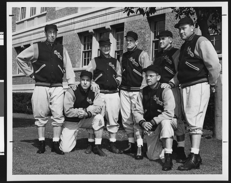 University of Southern California 1951 football coaching staff, in letter jackets, USC campus, 1951.