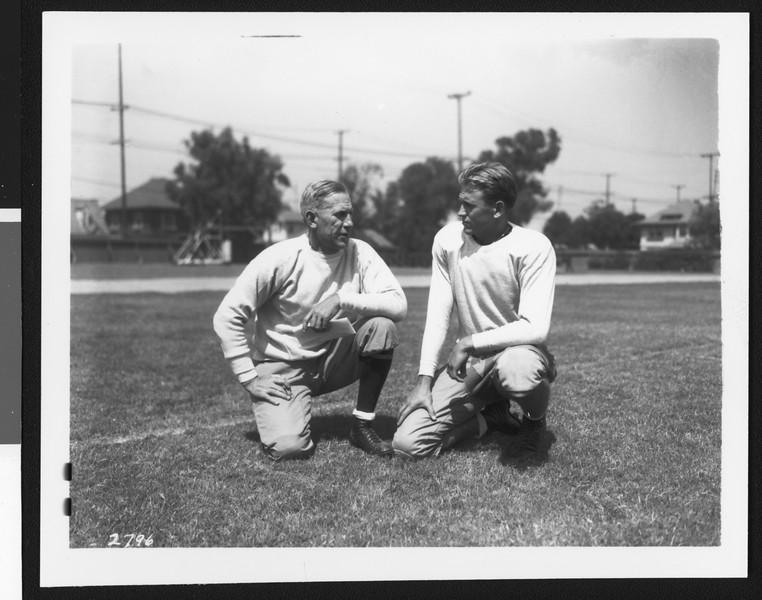 University of Southern California football coach Howard Jones and team captain Julie Bescos, Bovard Field, USC campus, 1934.
