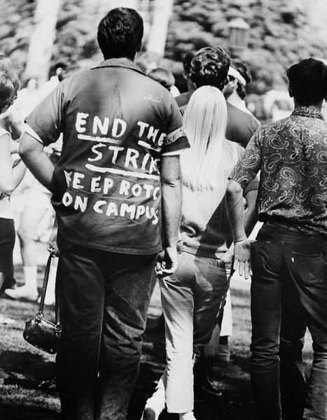 """Student wearing a shirt with words """"End the Strike keep ROTC on campus""""on the back, USC, 1970"""