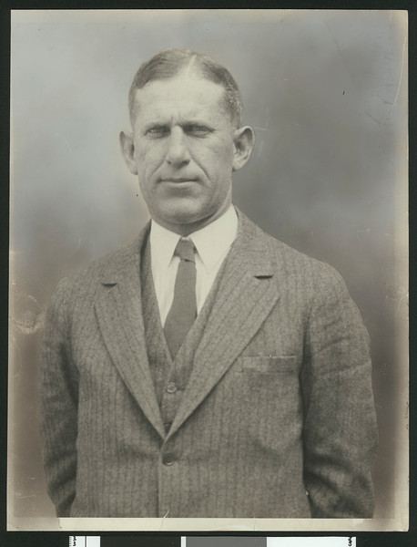 University of Southern California football coach Howard Jones, in pinstriped suit, waist up, 1925.