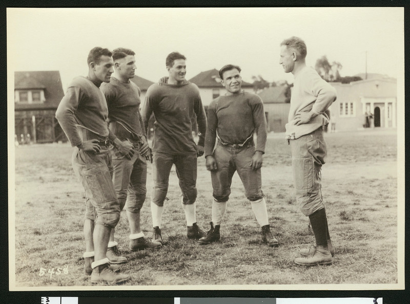 University of Southern California football coach Howard Jones with four players from the 1925 varsity squad, Bovard Field, USC campus, 1925.