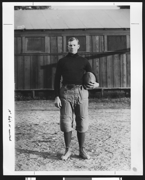 Dean Cromwell, famed University of Southern California sports coach, wearing a football uniform in 1908 standing on Bovard Field, USC campus, Los Angeles.