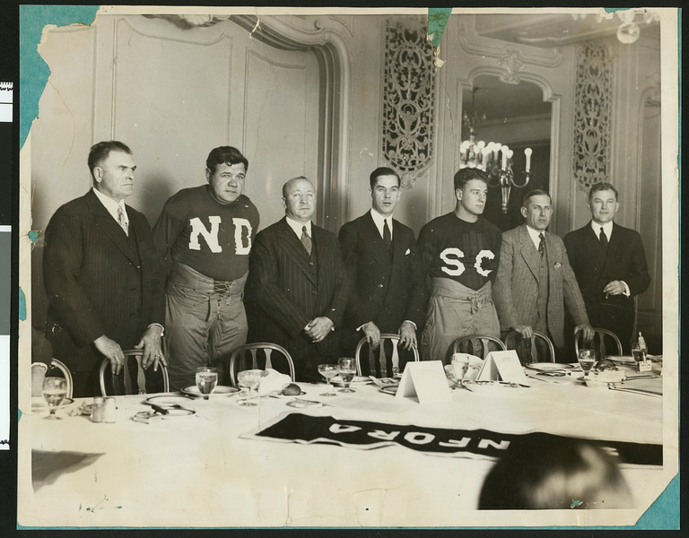 Football coaches and athletes at a dinner the night before the first University of Southern California - Notre Dame football game at Soldiers Field, Chicago, 1927.
