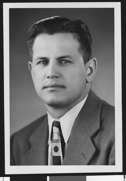 University of Southern California assistant football coach Joseph Muha, studio shot in geometric patterned tie and earth-toned jacket, 1951.