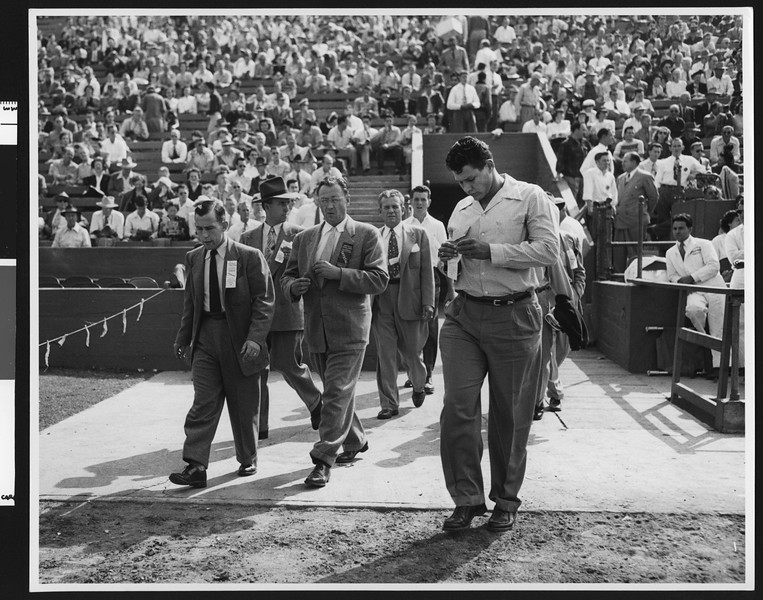 University of Southern California head football coach Jeff Cravath entering Los Angeles Memorial Coliseum for the USC-Rice game, 1948.