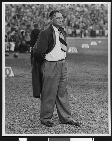 University of Southern California football coach Jeff Cravath on the sidelines at the Los Angeles Coliseum, 10-yard markers behind him, circa 1947-1949.