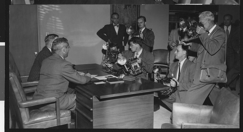 Press conference for new University of Southern California head football coach Jess Hill, with many photographers taking pictures, January 1951.