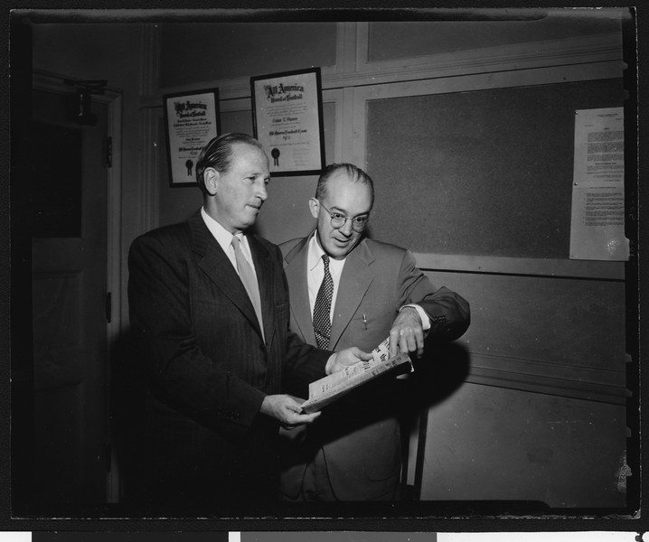 Los Angeles Times sports editor Braven Dyer with University of Southern California Athletic News Director Tom Lawless, USC campus, 1951.