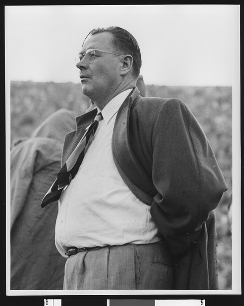 University of Southern California football coach Jeff Cravath on the sidelines at the Los Angeles Coliseum, shot to thigh level, circa 1947-1949.