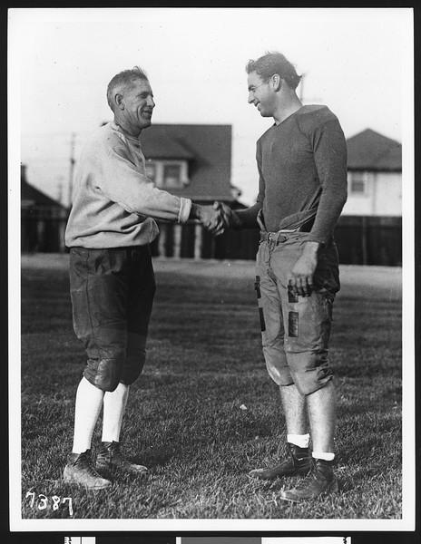 University of Southern California football coach Howard Jones shaking hands with quarterback Morley Drury, Bovard Field, USC campus, 1927.