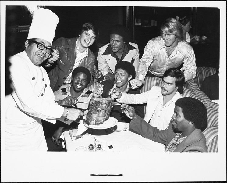 USC football players at a restaurant, [s.d.]