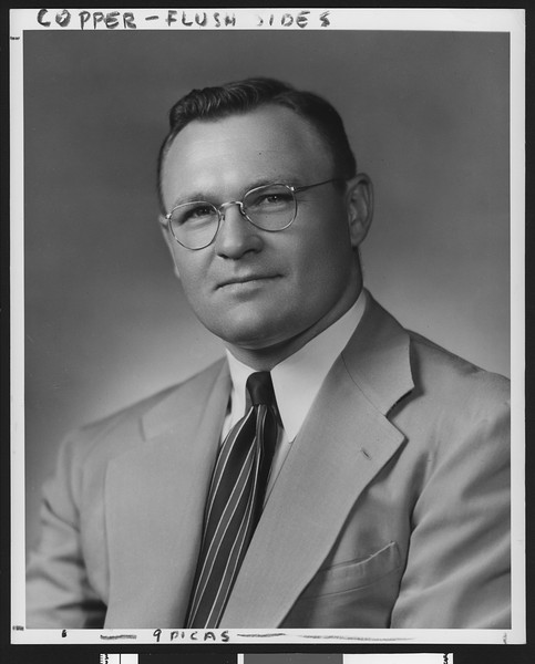 University of Southern California assistant football coach Harry Smith, studio shot in striped tie and light jacket, 1949.