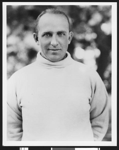 "University of Southern California football coach Elmer ""Gloomy Gus"" Henderson, waist up, ca. early 1920s. USC campus, Los Angeles."