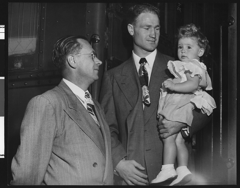 University of Southern California head football coach Jeff Cravath, and Paul Cleary? and daughter boarding a train, 1947.