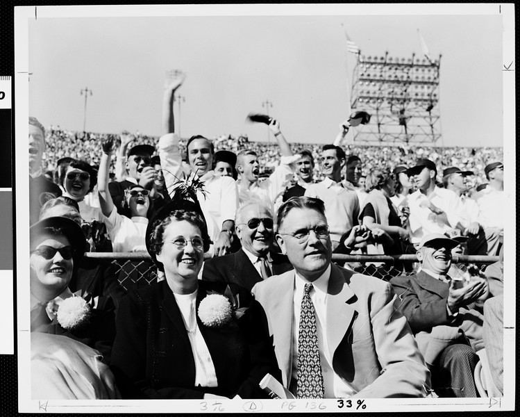 USC President Fred Dow Fagg, Jr. and Mrs. Fagg enjoying a football game at Coliseum, ca.1949