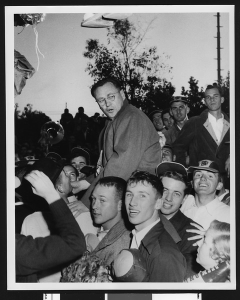 University of Southern California football coach Jeff Cravath being carried on top of celebrating students after the tie with Notre Dame, Los Angeles, 1948.