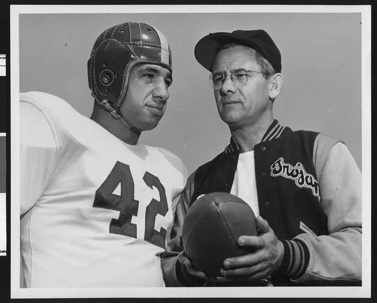 University of Southern California football coach Jess Hill (right) talking to player Pat Cannamela, Los Angeles, 1951.