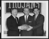 University of Southern California athletic director Jess Hill, John McKay, and Don Clark at the press conference for Don Clark's resignation and John McKay's succession as football coach, USC campus, 1959.