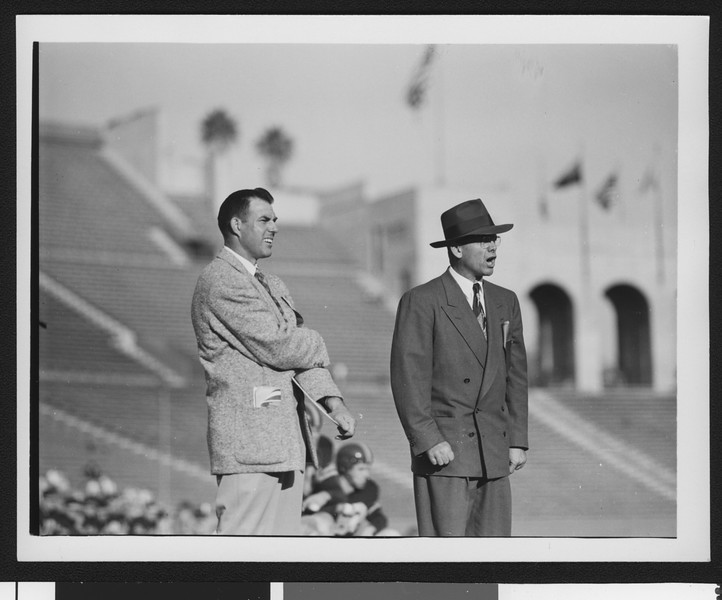 University of Southern California head football coach Jess Hill (right) yelling at a football pre-game practice at the Los Angeles Memorial Coliseum, 1951.