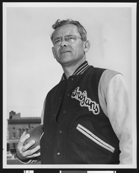 University of Southern California head football coach Jess Hill, wearing letter jacket and glasses, Bovard Field, 1951.